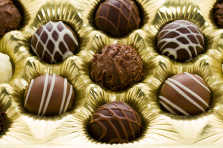 fancy sweet box: Box of assorted gourmet truffles on a white background.