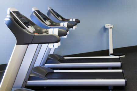 Treadmill machine ina  small gym. Stock fotó