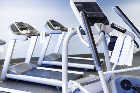 cardiovascular workout: Elliptical machine in a small gym