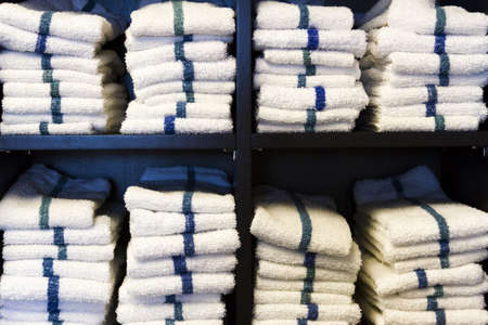 Stack of white towels in small gym  Stock fotó