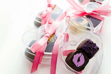 Miniature hear shaped boxes filled with gourmet truffles.