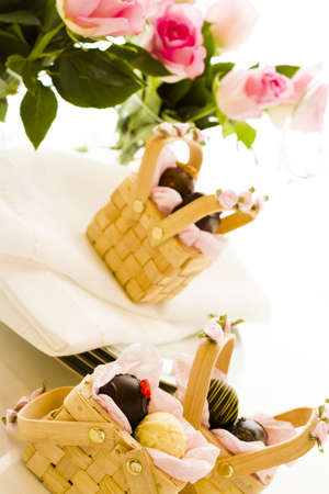 Miniature picnic baskets favor boxes filled with truffles. 写真素材