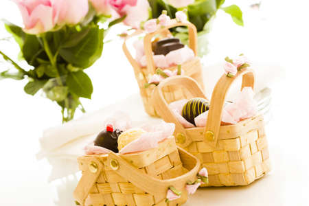 favor: Miniature picnic baskets favor boxes filled with truffles. Stock Photo