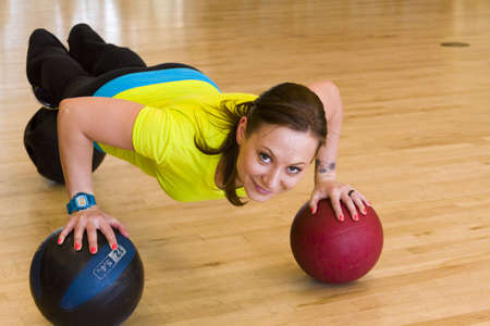 Younf woman exercising at the gum. Stock Photo