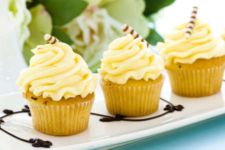 Small white chocolate cupcakes at desesrt bar. Stock Photo