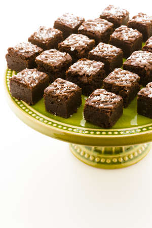 Small sweet and salry brownie bites at desesrt bar. Stock Photo