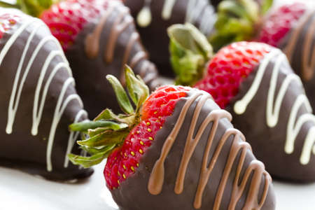 chocolate candy: Chocolate dipped strawberries at dessert bar.