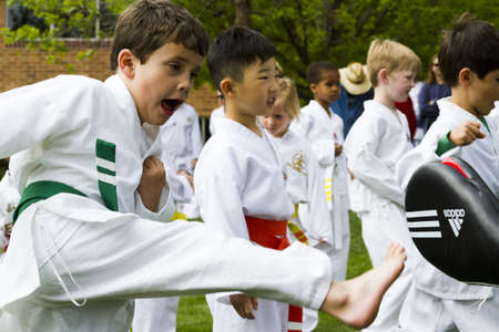 tae kwon do: Tae Kwon Do student practicing in the park.