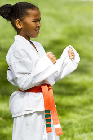 tae: Tae Kwon Do student practicing in the park.