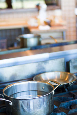 gas stove: Cooking pots and pans on a gas stove.