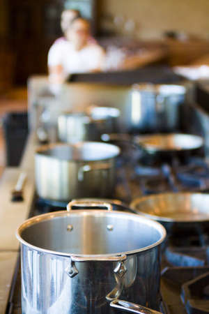 gas stove: Kids learning how to cook in cooking school. Stock Photo