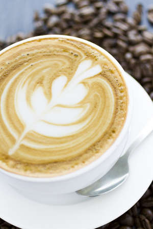 energizing: Gourmet caffe latte with leaf design in foam.
