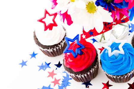 Patriotic holiday cupcakes decorated with stars. photo