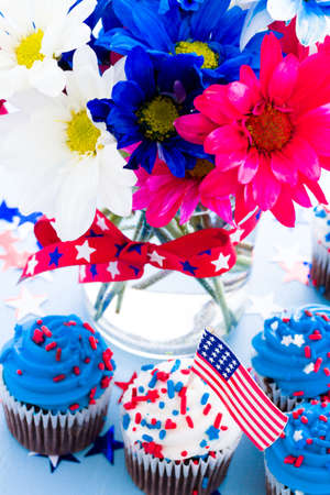 Patriotic holiday cupcakes decorated for july 4th. photo