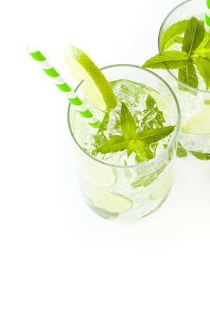 Mint mojito cocktail with slice of lime as a garnish. photo