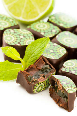 Mint mojito truffles on a white background. photo