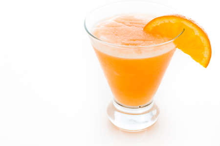 Fuzzy naval cocktail with orange wedge as a garnish.