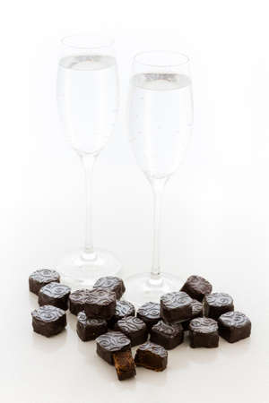 champagne truffles chocolate: Champagne truffles with silver dust on a white background. Stock Photo