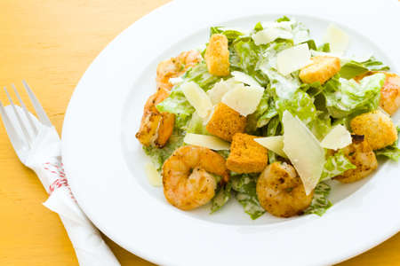Gourmet caesar salad with grilled shrimp and croutons. photo