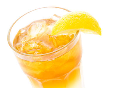 lemon wedge: Arnold Palmer cold drink with lemon wedge.