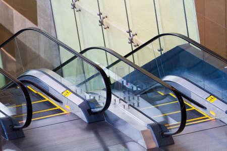 Escalator in modern building. Banco de Imagens