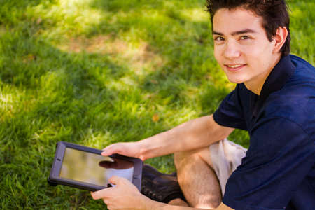 College student with computer tablet on campus.