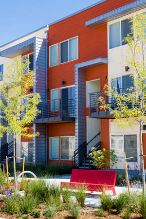 multifamily: Modern arapartment complex painted in bright colors.