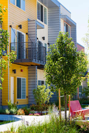 living unit: Modern arapartment complex painted in bright colors.