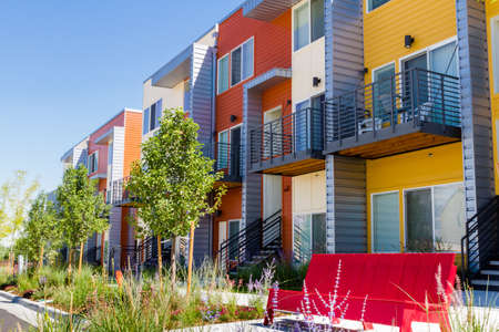 Modern arapartment complex painted in bright colors.