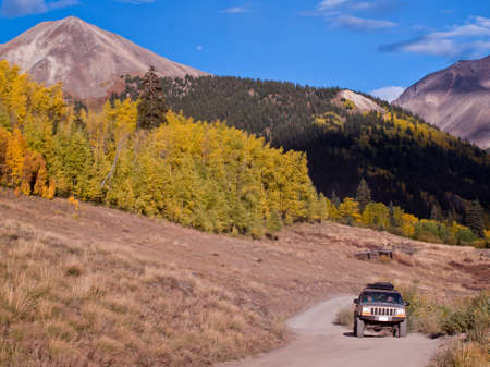Jeep on Cinnamon Pass in autumn, Colorado. photo