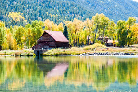 Old barn by the lake in autumn. Near Lake City, Colorado.