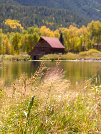 Old barn by the lake in autumn. Near Lake City, Colorado. photo