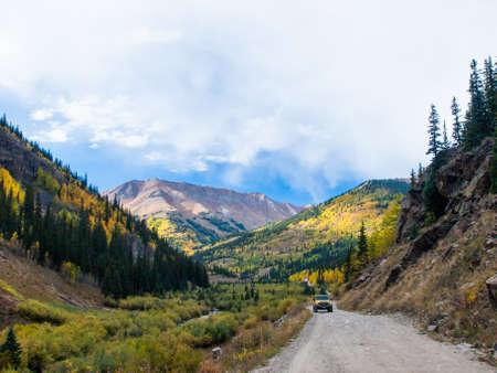 Yellow Jeep on Cinnamon Pass in autumn, Colorado. photo