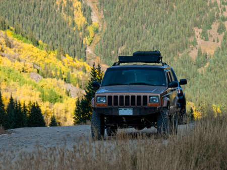 Jeep on Cinnamon Pass in autumn, Colorado. photo