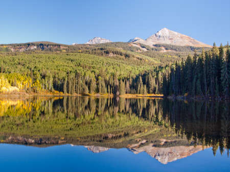 Autumn in perfect reflection of Woods Lake, Colorado. photo