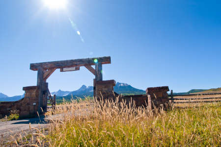 the back gate: Gate of the Last Dollar Ranch in autumn with a view of the Dallas Divide on the back. Stock Photo