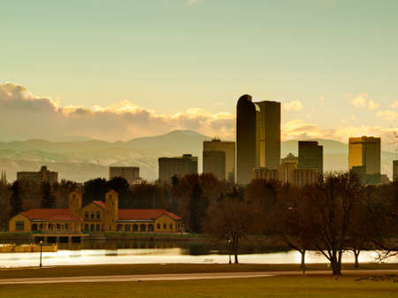 denver skyline with mountains: A view of Denver, Colorado downtown right before sunset. Stock Photo