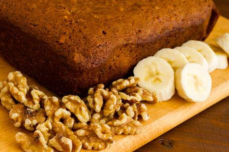 banana bread: Freshly baked classic banana bread with walnuts and bananas. Stock Photo