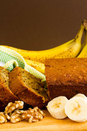 Freshly baked classic banana bread with walnuts and bananas. photo