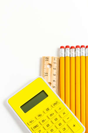 Variety of school supplies on a white background.