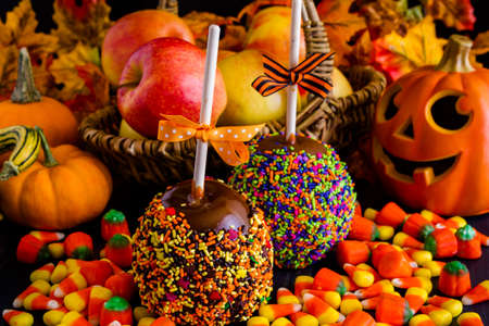 Hand dipped caramel apple covered with multi color sprinkles. Stock Photo