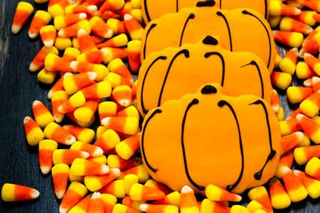 candy corn: Sugar cookies with orange icing shaped like a pumpkin.
