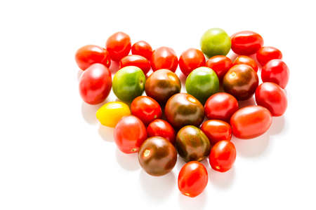 Multicolored cherry tomatoes picked from organic garden. Stockfoto