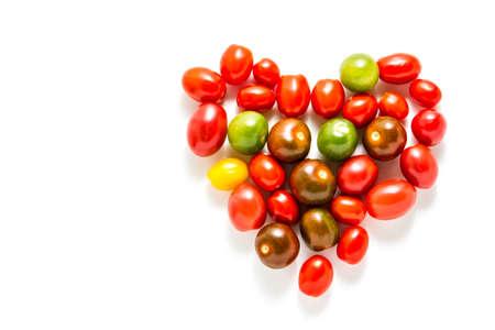 Multicolored cherry tomatoes picked from organic garden. Zdjęcie Seryjne