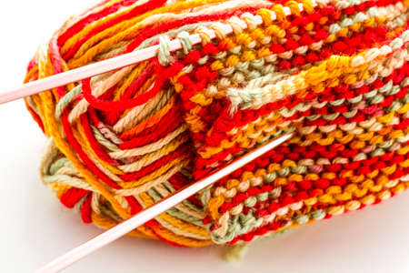 Knitting with multi colored yarn with orange, red, and yellow tones. Stock Photo - 22856174