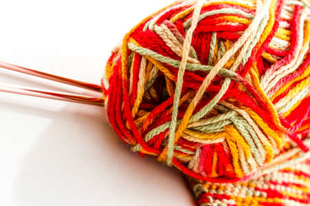 nad made: Knitting with multi colored yarn with orange, red, and yellow tones. Stock Photo
