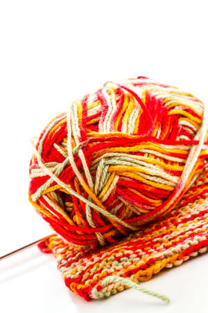 Knitting with multi colored yarn with orange, red, and yellow tones. Stock Photo - 22856210