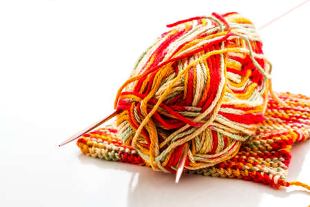 Knitting with multi colored yarn with orange, red, and yellow tones. Stock Photo - 22856429