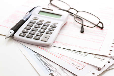tax return: Calculating numbers for income tax return with pen and calculato