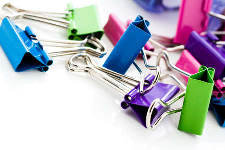 Multicolored paper clips in a pile on a white background. Stock Photo - 23173211